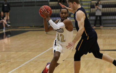 Men's basketball wins third straight with victory over coach's alma mater