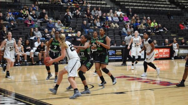 Kallie+Bildner+attempts+to+go+up+for+a+shot+while+being+guarded+by+defenders+in+a+game+against+the+University+of+Arkansas-Monticello+on+Nov.+11.++Photo+by+Rolando+Dupuy