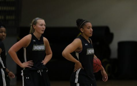 Kallie Bildner (left) and Gabby Walker in practice fresh off a 13-point win over undefeated University of Illinois - Springfield. <br>Photo by Walker Van Wey</br>
