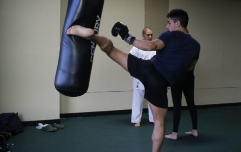 Tony Andrades, a seven-year Muay Thai veteran, warms up before a Wednesday practice. <br>Photo by Walker Van Wey
