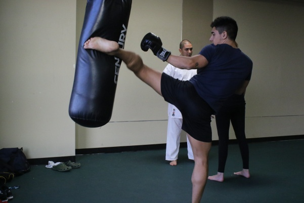 Tony Andrades, a seven-year Muay Thai veteran, warms up before a Wednesday practice. Photo by Walker Van Wey