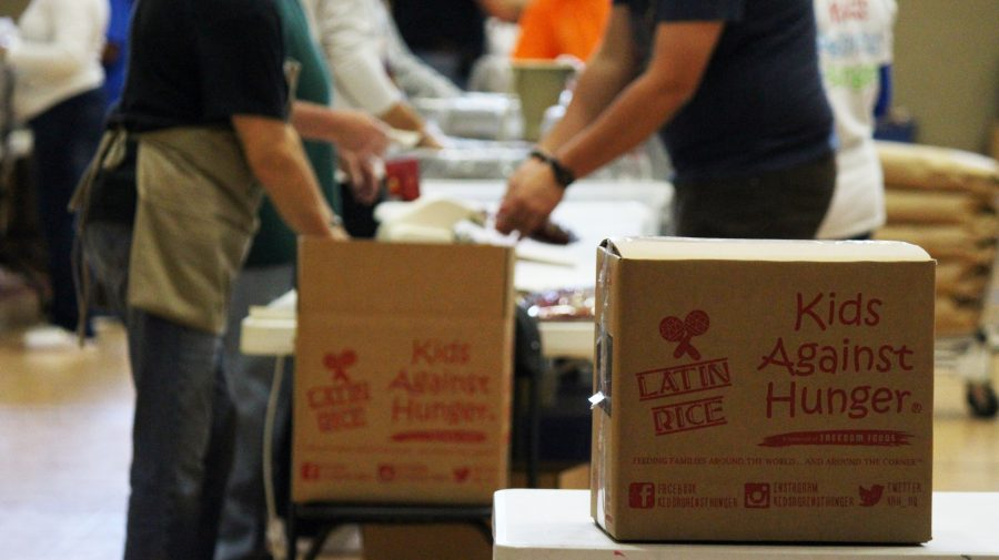 Volunteers+are+packing+meals+for+children+in+need+both+locally+and+overseas.+Kids+Against+Hunger+organizers+are+planning+to+pack+thousands+of+meals+consisting+of+rice%2C+soy+and+more+this+weekend.+%3Cbr%3EPhoto+by+Kyle+Rainey