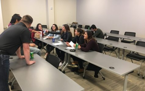Interested students and faculty discuss the plans for their future Greek organization at the Latin coed interest meeting on Friday, Nov. 10, in the LARC. <br> Photo by Ciara Griffin.