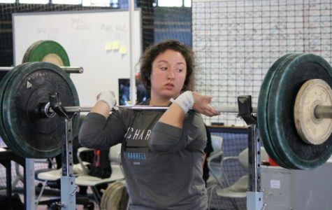 Chelsey McMichael takes the bar off the rack in a Tuesday practice preparing for Lindenwood's next meet in January. <br>Photo by Walker Van Wey</br>