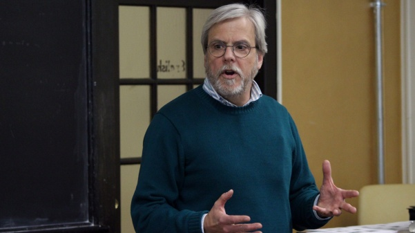 History professor Jeffrey Smith lectures a class on the roots of modern advertising.  Photo by Kyle Rainey