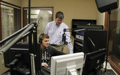 Student Dillon Archer (left) and Chad Briesacher on air in the KCLC radio station in the Spellmann Center on Sept. 27. In his new position, Briesacher will devote his full attention to KCLC. <br> Photo by Lindsey Fiala