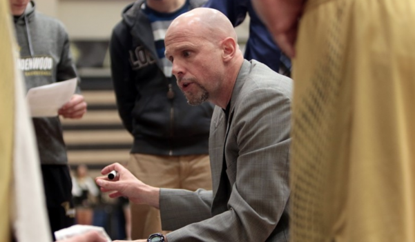 Men's basketball coach Lance Randall addresses his team at Hyland Arena.  Photo by Don Adams Jr.