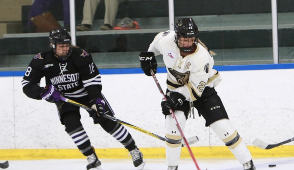 Lindenwood+women%27s+hockey+player+Britannia+Gillanders+competes+for+the+puck+against+Minnesota+State+on+Sept.+30+at+the+Lindenwood+Ice+Arena.++Photo+by+Don+Adams+Jr.