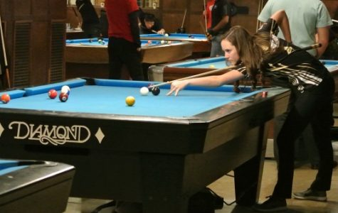 Freshman Taylor Hansen midway through a mid Sunday match in the University of Michigan Team Pool Championship. An event that she and Briana Miller made history by winning. Photo by Alan Oliver