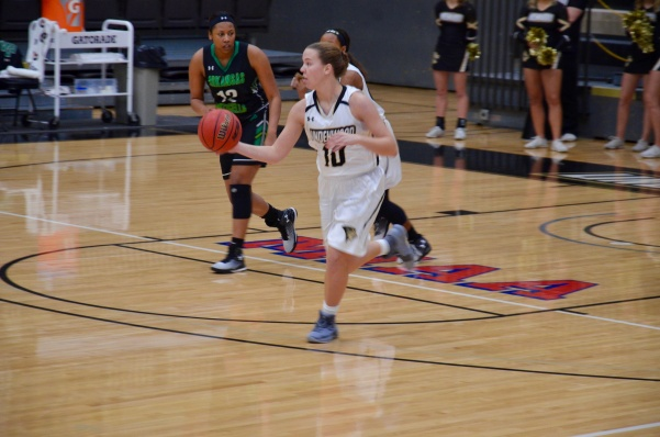 Kenzie Guese dribbles the ball down the court in a game vs the University of Arkansas-Monticello on Nov. 11. <br> Photo by Rolando Dupuy.