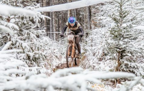 Hannah Finchamp rides her bike through icy terrain during the 2016 USA Cycling Collegiate Mountain Bike National Championships in Snowshoe, Virginia. Finchamp won the event which was held from Oct. 21 - 23 2016. <br> Photo provided by Hannah Finchamp