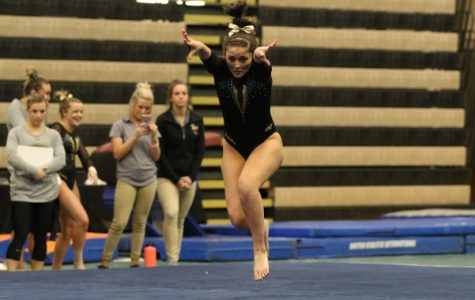 Senior Kayla McMullan in her floor routine, the final routine of Saturday's Black and Gold exhibition in Hyland Arena. <br>Photo by Walker Van Wey </br>