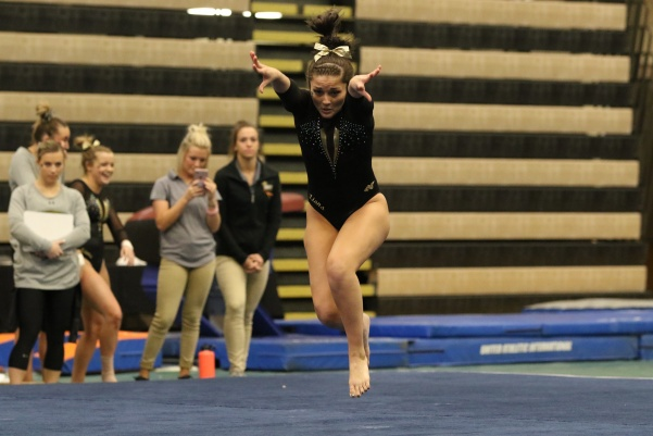Senior+Kayla+McMullan+in+her+floor+routine%2C+the+final+routine+of+Saturday%27s+Black+and+Gold+exhibition+in+Hyland+Arena.+%3Cbr%3EPhoto+by+Walker+Van+Wey+%3C%2Fbr%3E
