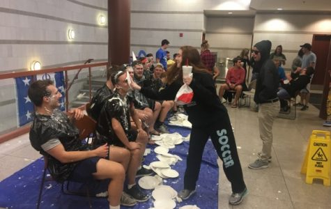 Phi Delta Theta members are pied by students at their annual Pie a Phi event in the Spellmann Cafeteria on Nov. 29.<br>Photo by Ciara Griffin.</br>