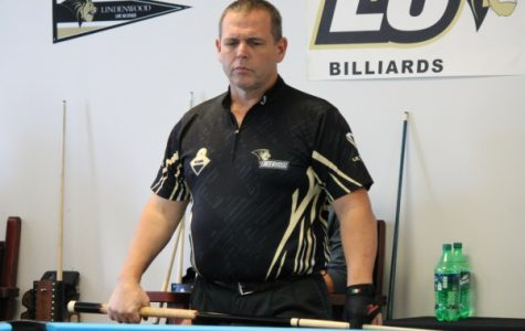 Alan Oliver eyes the table during a match against Salvo's Slayers. Oliver went 1.5-0.5 on the day. <br>Photo by Walker Van Wey</br>