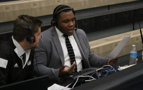 Adam Ziske (left) looks to broadcast partner Romero Starks as he breaks down the first half of the Lions basketball match up against Central Christian College of the Bible on Dec. 1.. <br>Photo by Walker Van Wey</br>