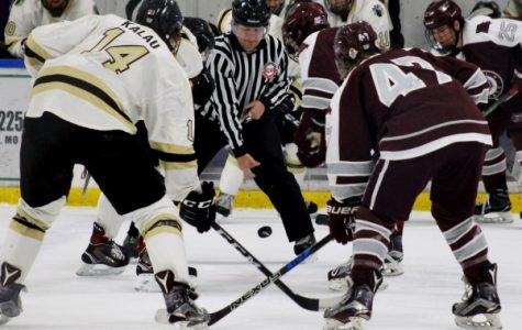 Forward Alex Kalau at the face-off against Missouri State on Nov. 11 at the Wentzville Ice Arena. Kalau had two assists on Dec. 2 against the University of Illinois at the Illinois Ice Arena. File photo by Kayla Bakker.