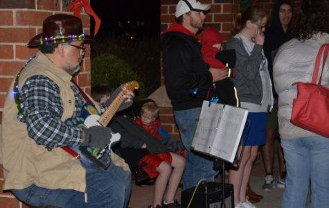 Dean of Science Ricardo Delgado plays guitar during the Christmas Walk in 2017.<br> Photo by Rolando Dupuy