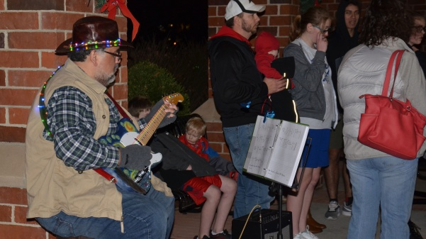 Dean of Science Ricardo Delgado plays guitar during the Christmas Walk in 2017. Photo by Rolando Dupuy