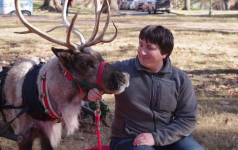 Lindenwood student Maxwell Kolkmeier pets Jingles the reindeer for CAB's Rad Reindeer on the quad Friday. <br> Photo by Kat Owens </br>