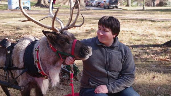 Lindenwood+student+Maxwell+Kolkmeier+pets+Jingles+the+reindeer+for+CAB%27s+Rad+Reindeer+on+the+quad+Friday.+%3Cbr%3E+Photo+by+Kat+Owens+%3C%2Fbr%3E