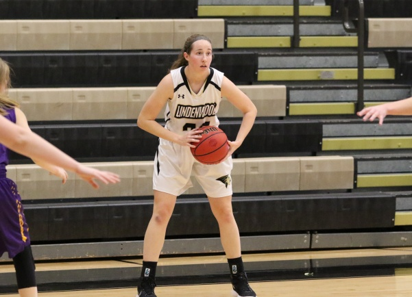 Megan+Foster+%28No.+32%29+looks+to+pass+in+Lions%27+82-41+win+against+St+Louis+College+of+Pharmacy+on+Nov.+27.++%3Cbr%3EFoster+had+season+high+14+points+in+teams%27+loss+on+Thursday.%0A%3Cbr%3E%0APhoto+by+Walker+Van+Wey