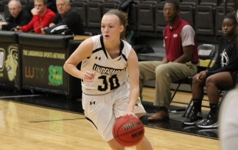 Lindsay Medlen, No. 30, drives to the bucket in Lions' 113-30 win against Christian College of Bible on Dec. 1st.  Medlen registered 8 points in the loss on Saturday. <br>  Photo by Walker Van Wey