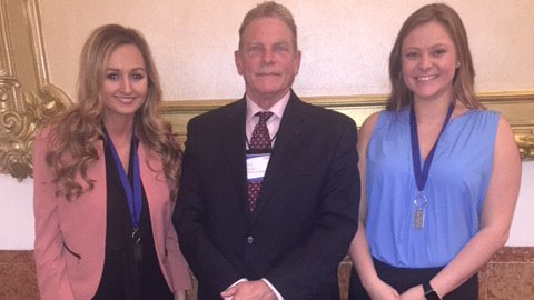 Savannah Bice, Craig Felzien and Monica Friedman in New York after both women won the top prize at the Collegiate DECA National Competition Nov. 9-11.  Photo provided by the Plaster School of Business and Entrepreneurship