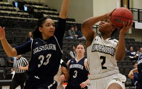 In a file photo from 2017, Lindenwood's Charisse Willams tries to get a layup past Washburn's Denesia Smith at the Hyland Arena in St. Charles. <br> Photo by Walker Van Wey. </br>