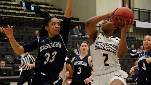 In a file photo from 2017, Lindenwood's Charisse Willams tries to get a layup past Washburn's Denesia Smith at the Hyland Arena in St. Charles.  Photo by Walker Van Wey.