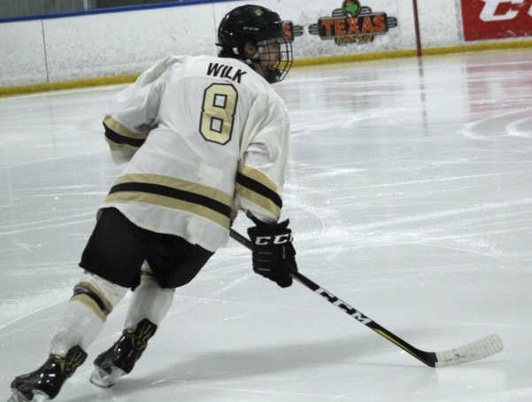 File Photo: Lindenwood defenseman Austin Wilk looks towards the puck during the Lions hockey game against Missouri State on Nov. 10 at Wentzville Ice Arena. The Lions won the game 6-3.