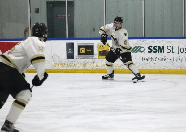 Junior defenseman Tommy Heinzman looks to make a pass to sophomore defenseman Aapo Nurminen during the Lions game against the Missouri State Ice Bears on Nov. 10 at the Wentzville Ice Arena. The Lions defeated the Ice Bears 6-3 during that Friday's game. File photo by Kayla Bakker.