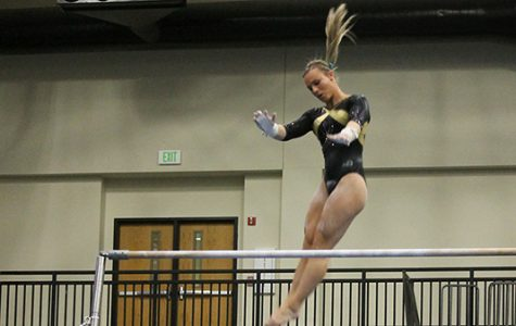 Lindenwood gymnast Kierstin Sokolowski does her routine on the bars at the team's home opener on Jan. 19. The Lions hosted the University of Alaska Anchorage and Centenary College.  <br> Photo by Michelle Sproat. </br>