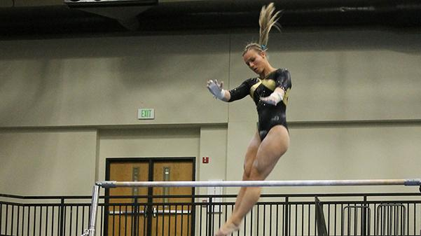 Lindenwood gymnast Kierstin Sokolowski does her routine on the bars at the team's home opener on Jan. 19. The Lions hosted the University of Alaska Anchorage and Centenary College.   Photo by Michelle Sproat.