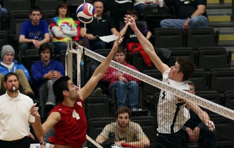 Lindenwood volleyball player Adam Brewster (white jersey) hits the ball. The Lions have opened the season with a 5-2 record and will look to get two wins against Grand Canyon and Lincoln Memorial this weekend. <br/> Stock photo by Carly Fristoe
