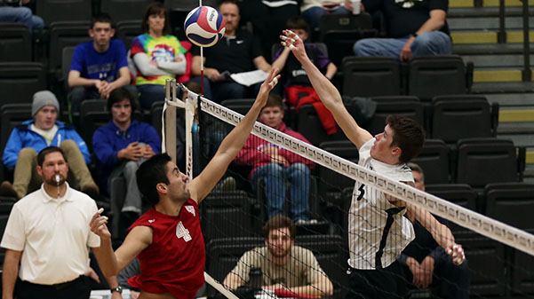 Lindenwood volleyball player Adam Brewster (white jersey) hits the ball. The Lions have opened the season with a 5-2 record and will look to get two wins against Grand Canyon and Lincoln Memorial this weekend.  Stock photo by Carly Fristoe