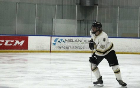Senior defenseman Brett Bauza looks to pass the puck against the Missouri State Ice Bears at the Wentzville Ice Arena. Bauza will be one of six seniors honored before Saturday's game.  File photo by Kayla Bakker.
