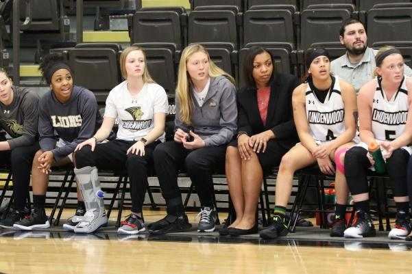 Kallie Bildner (grey jacket) watches as the Lions lose 71-65 to Missouri Southern on Thursday. Bildner missed her second straight game on Saturday due to injury.  Photo by Walker Van Way