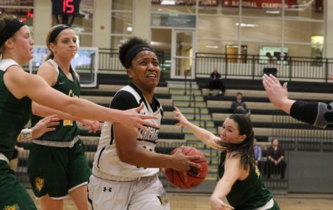 Sara Ross, No. 11, drives in the lane for the bucket in Lions' 71-65 loss Thursday night against Missouri Southern. Ross finished the game matching her season high with 20 points. <br> Photo by Walker Van Way