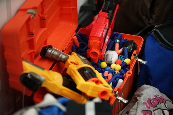 A+bucket+of+Nerf+blasters+and+darts+sits+in+the+sidelines.+Regular+participants+often+bring+extra+equipment+to+events+so+that+new+players+can+join+in.++Photo+by+Mitchell+Kraus