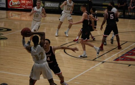 In a file photo from February 2018, guard Brad Newman prepares to pass to forward Chandler Diekvoss (No. 10) in Lindenwood's game against Central Missouri. <br > Photo by Matt Hampton