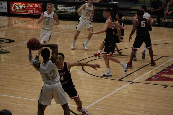 In a file photo from February 2018, guard Brad Newman prepares to pass to forward Chandler Diekvoss (No. 10) in Lindenwood's game against Central Missouri.  Photo by Matt Hampton