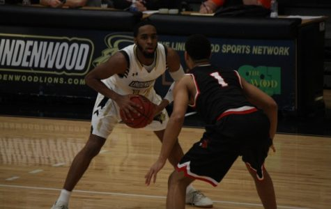File Photo. Junior guard Brad Newman stares at a UCM defender on Feb. 17. Newman scored a career-high 31 points on Saturday in Lindenwood's 88-70 win over Missouri Western.