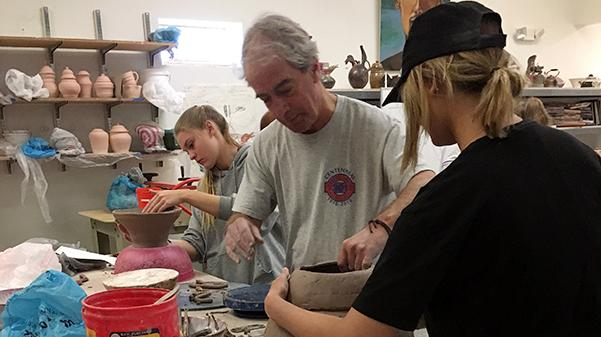 Professor Grant Hargate assists students with a studio art project.  Photo by Andria Graeler