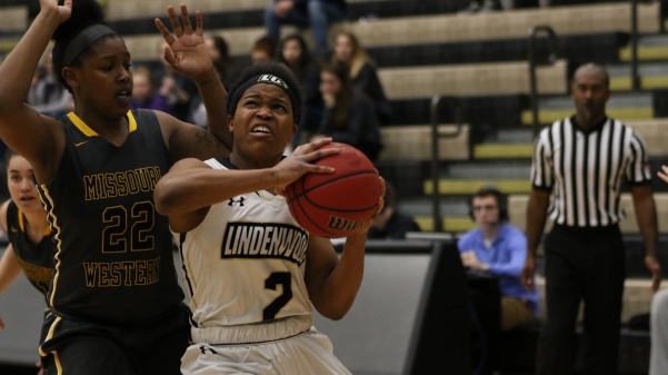 Guard Charisse Williams, No. 2, drives to the basket in the Lions' 61-50 win against Missouri Western Saturday afternoon.  Photo by Kyle Rhine
