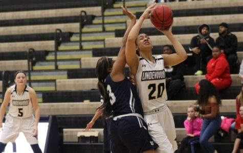 Forward Gabby Walker, No. 20, gets the bucket in Lions' 83-73 win over Lincoln University. Walker tallied nine points in the win.  Photo by Kyle Rhine