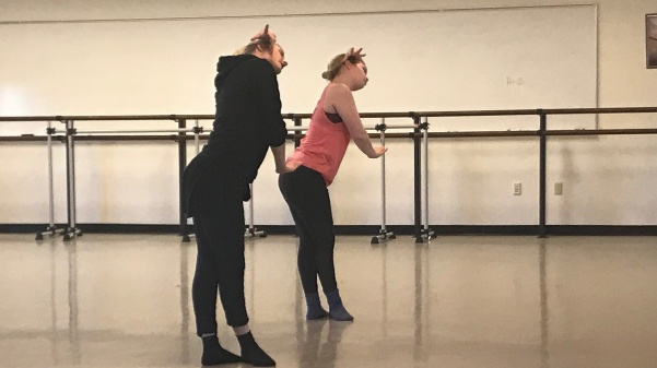 Kate Harpootlian, left, works with student Sydney Gibbs during a choreography session on Monday, Feb. 26, with the cast of the upcoming Spring Dance Concert.  Photo by Megan Courtney