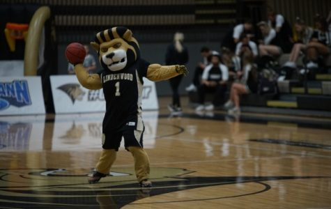 Leo the Lion throws a basketball at the Lindenwood women's basketball game against Nebraska-Kearney on Jan. 25. <br/> Photo by Mitchell Kraus.