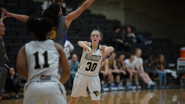 Guard Lindsay Medlen pass the ball in the Lions' 80-78 loss to Nebraska-Kearney back on Jan. 25.  Medlen scored 8 points in the loss.  Photo by Mitchell Kraus