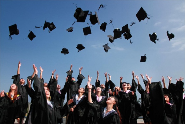 At this semester's commencement, undergraduate ceremonies will be split by school.  Photo from pexels.com